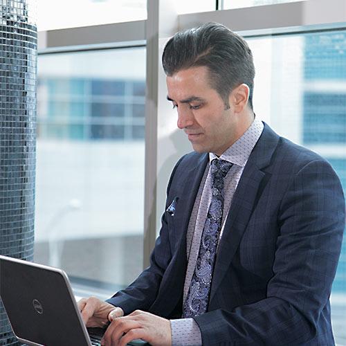 Gino Paciocco lawyer working on laptop